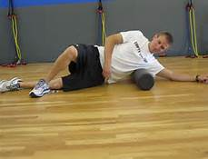 lie on the roller such that it is positioned just below your armpit for at least a minute