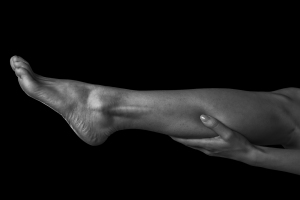 Try putting your hand on the back of your leg and pointing your toe. You will feel the muscles contract. If you slide your hand down towards your foot you will be able to locate your Achilles tendon.